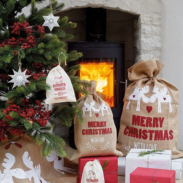 Decorated Christmas Tree and fireplace with present sacks